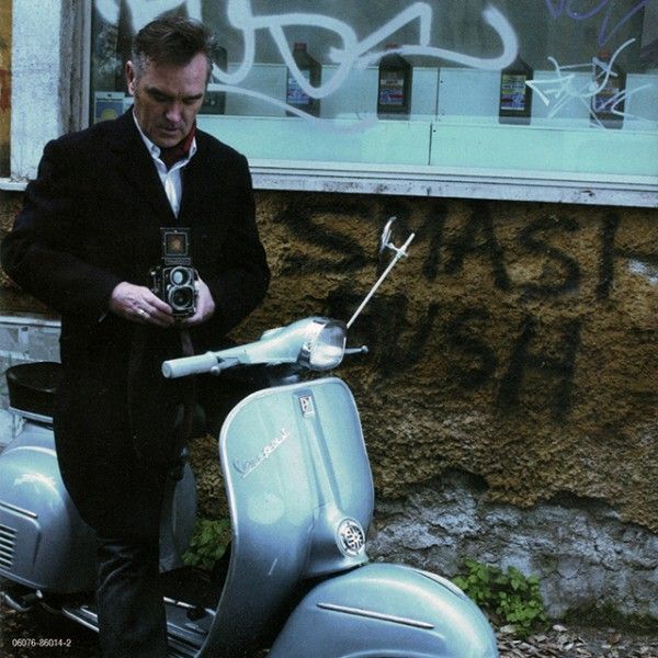 Morrissey with a Rolleiflex on a Vespa