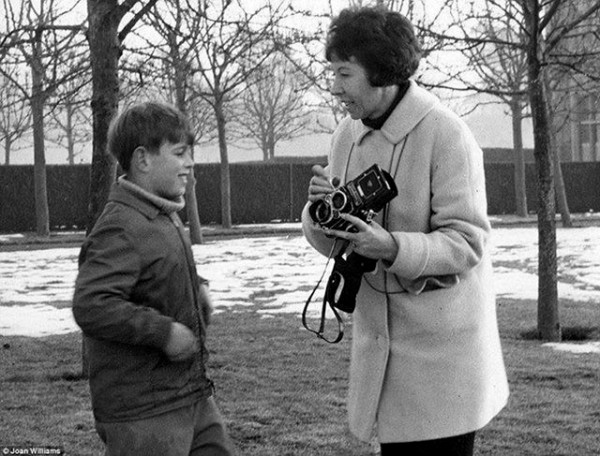 Prince Andrew, aged nine, talks with photographer Joan Williams about her camera in 1969